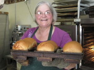 Laura Moore with fresh-baked loaves of bread. Photo: Cathy Stanton