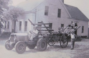 John Mahan (driving tractor) and his son-in-law George Crombie prepare for haying along with young helpers, 1942. Photo courtesy of Susan Twarog. Click for larger image.