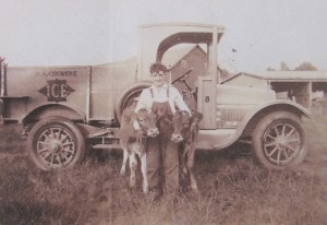 A young George Crombie in the 1920s, standing in front of his family's ice truck but clearly displaying his preference for farming. Photo courtesy of Susan Twarog